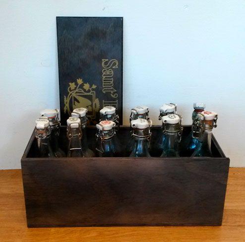 boligtilbehoer kasse med sodavandsflasker 12stk